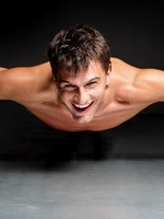 smiling-man-doing-push-ups-200-300