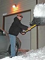 shoveling-snow-at-night