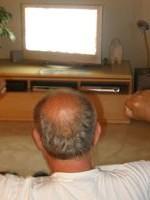 man-cheering-in-front-of-tv-200-300